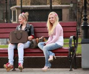 Two women sitting on the bench