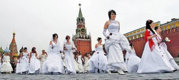 Russian brides parade in Red Square in Moscow