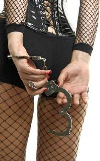 Girl in sexy fish net holding handcuffs behind her back