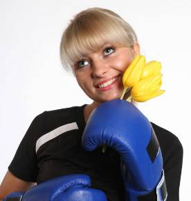 Woman with boxing gloves with flower.