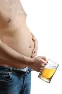 A man with big belly with mug of beer
