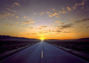 A straight road goes to the rising sun.